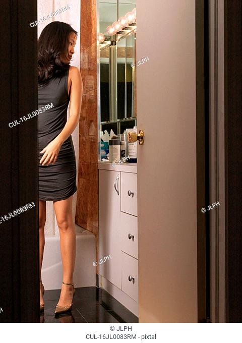 Woman watching herself in mirror