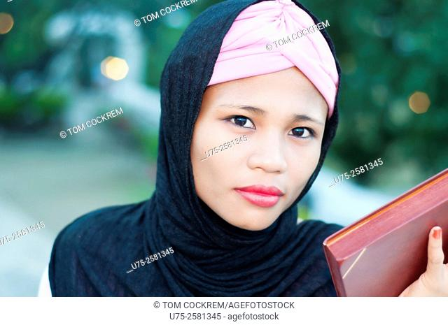 Portrait of young Asian Islamic woman wearing hijab on location, Cebu, Philippines