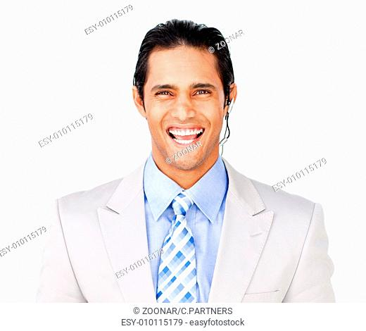 Smiling businessman with headset on against