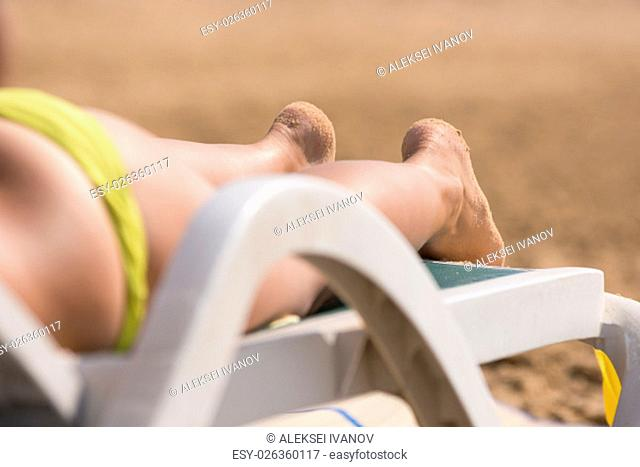 Part of the deck chairs on the beach with legs