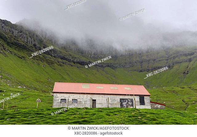 Sheep shelter on Kalsoy. Nordoyggjar (Northern Isles) in the Faroe Islands, an archipelago in the north atlantic. Europe, Northern Europe, Scandinavia, Denmark