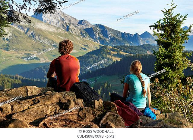 Hikers enjoying view of mountains, Manigod, Rhone-Alpes, France