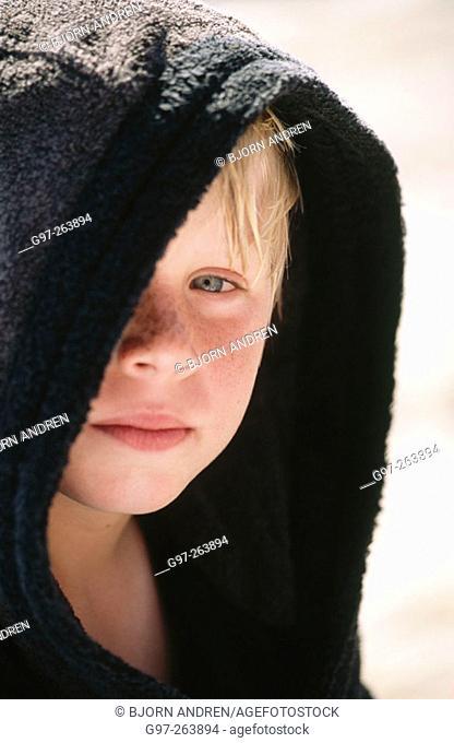 Boy in black bathrobe