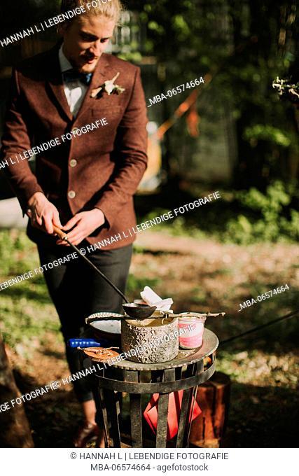 Alternative wedding, bridegroom at free ceremony, ritual