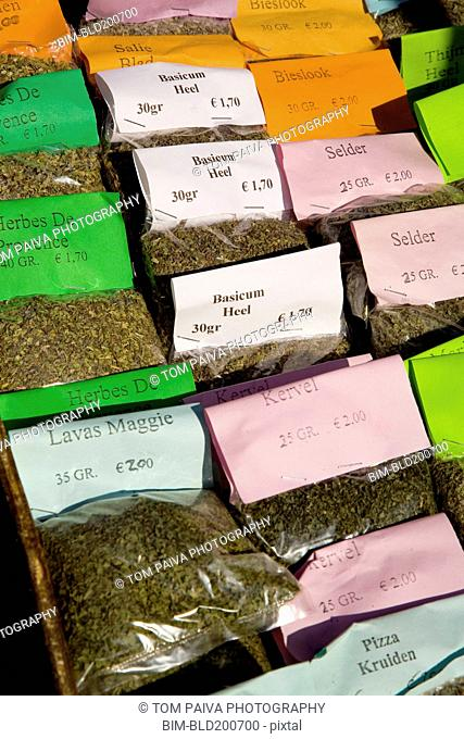 Packages of herbs for sale in market
