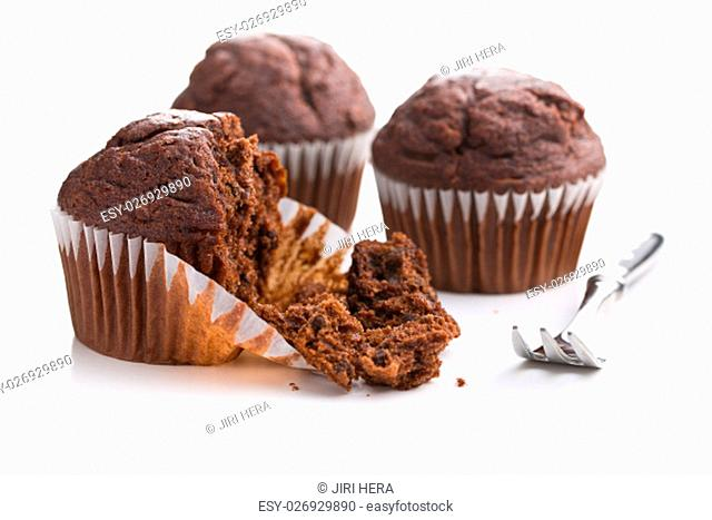 The tasty chocolate muffins isolated on white background