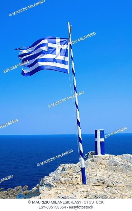 Flag and pylon with insignia of Greece, near Kastro on the island of Skiathos