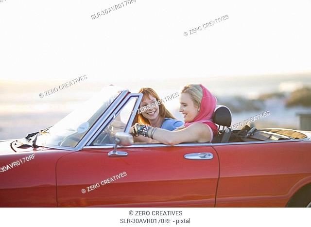 Woman sitting in a convertible car