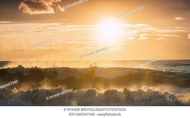 Sun Shining Over Horizon At Sunset Or Sunrise. Evening Sea. Ocean Waves In Warm Colors Sunset Sunrise Sky Lights. Natural Sky