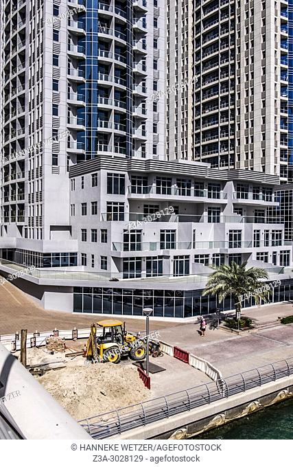 Construction site in front of brand new apartments at Dubai Marina, Dubai, UAE
