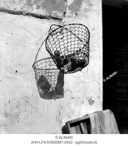 Basket hanging on the wall of a mill in Burano, Venice, shot 1945 ca. by Leiss Ferruccio