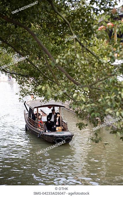 Tourists on excursion boats, Zhujiajiao, China