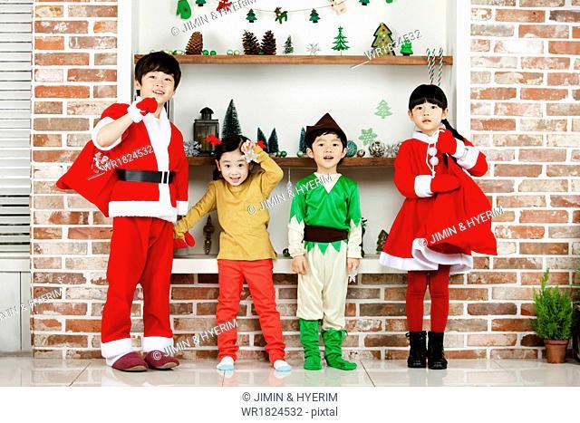 Four kids wearing costumes