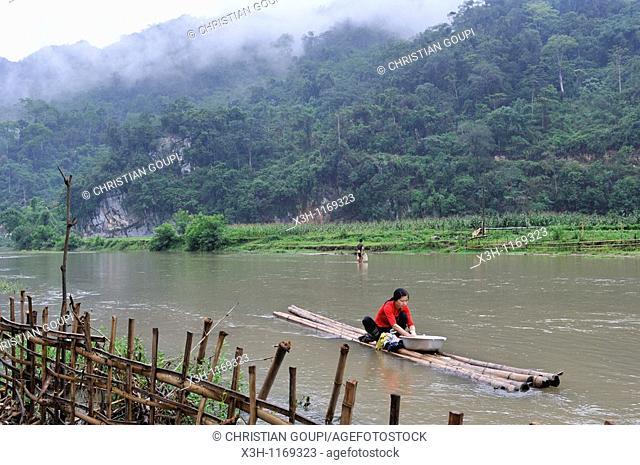 woman doing washing on the lakeshore,Ba Be Lake,Bac Kan province,Northern Vietnam,southeast asia