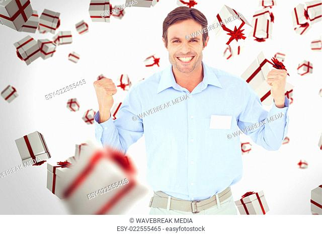 Composite image of happy businessman celebrating victory