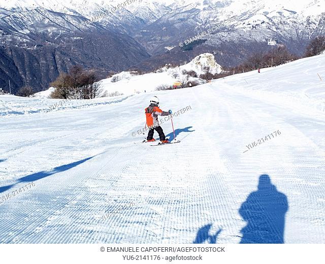 Little girl skiing on the slopes of Mottarone, Stresa, Piedmont, Italy
