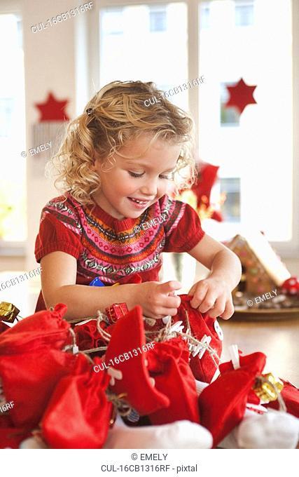 young girl playing with gift sacks