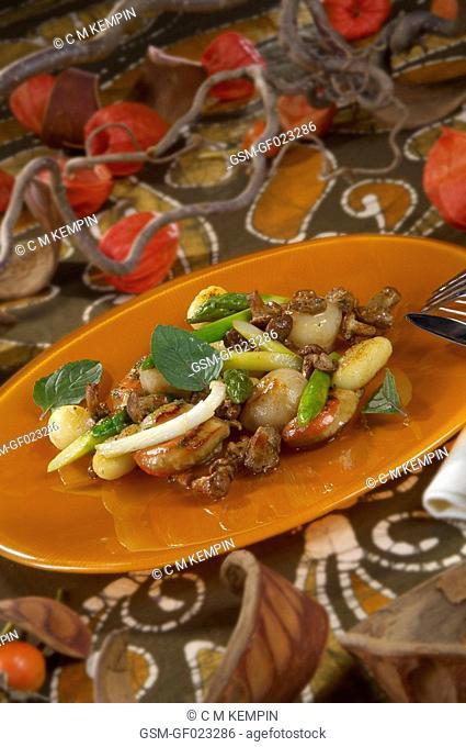 Scallops sautéed with wild mushrooms