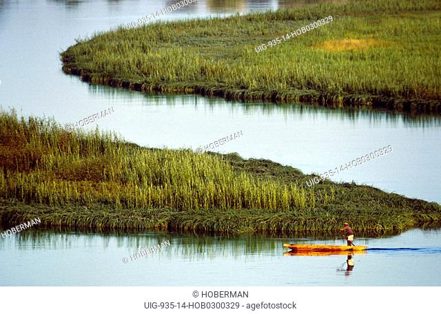 Boatman crossing the Kavango in a mokoro, Namibia