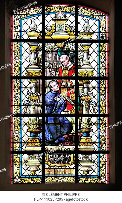 Stained-glass window in church at Tremelo, Belgium showing Father Damien / Saint Damien of Molokai / Jozef De Veuster, Roman Catholic missionary who ministered...