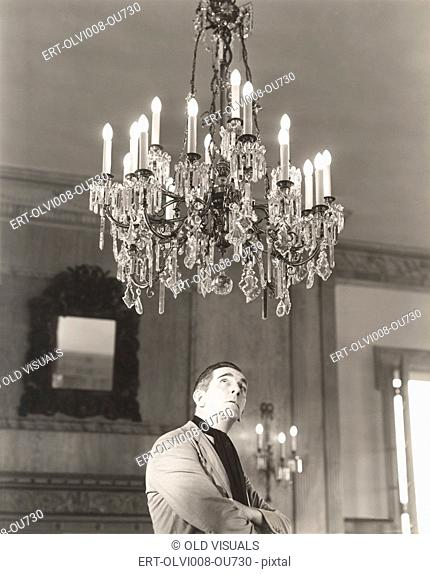 Man staring at chandelier