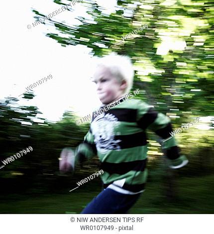 Boy running outdoors