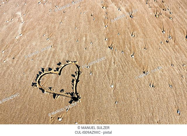 Heart drawn on beach, Venice, Italy