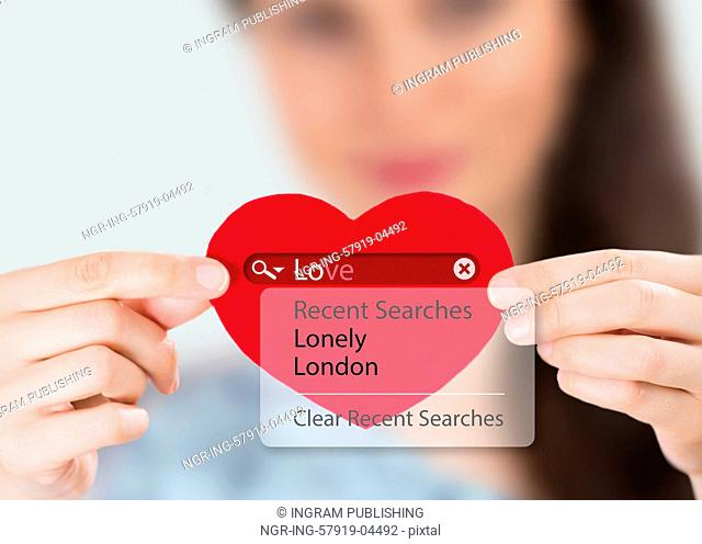Love search. Young woman holding red heart with love search options