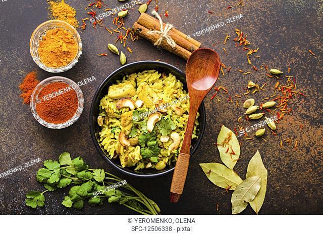 Chicken biriyani and cashew nuts (India)