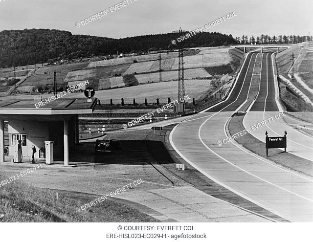 Service Station of the German Autobahn a four lane divided highway with entrance and exit ramps. Ca. 1938. LC-USZ62-128818