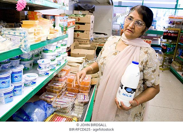 Older woman in a supermarket shopping for groceries