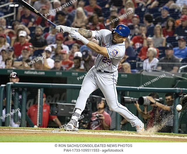 New York Mets first baseman Dominic Smith (22) swings at a pitch in the dirt in the first inning against the Washington Nationals at Nationals Park in...