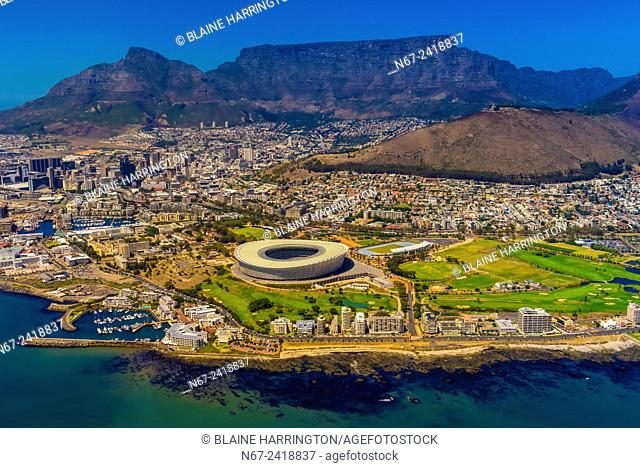 Aerial view of Cape Town (Cape Town Stadium in foreground, Signal Hill and Table Mountain in background), South Africa