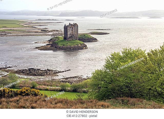 View of island castle on lake, Castle Stalker, Argyll, Scotland