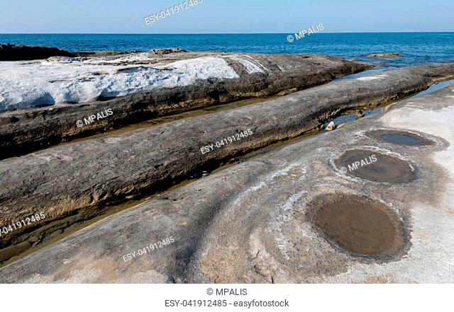 Rocky coast with white lime stones forming wonderful patterns at the area of Davlos, Northern Cyprus