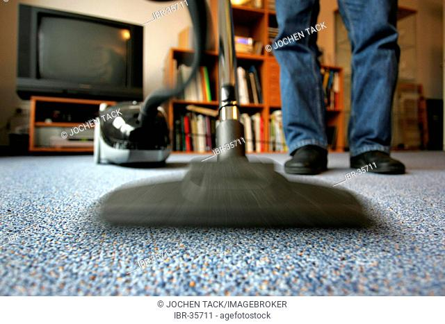 DEU, Germany : Housecleaning in a private house/apartment, vacuum cleaning