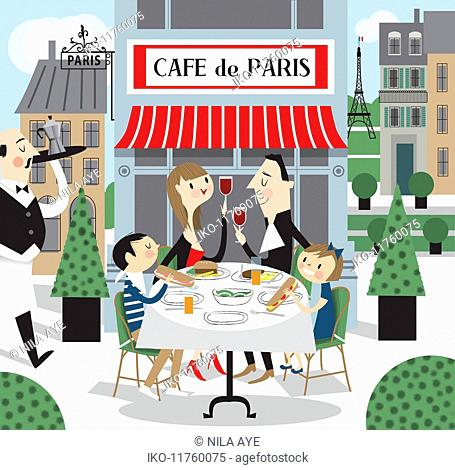 Family eating lunch together at a pavement cafe in Paris, France