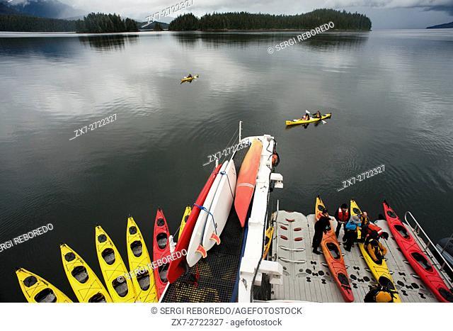 Sea kayaks next to cruise ship Safari Endeavour near Reid Glacier in Glacier Bay National Park, Alaska, USA. All of our trips use double kayaks.