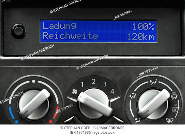 Display on the dashboard of a Suzuki Splash electric car, display showing that the battery is 100 per cent charged, resulting in a 120 km range