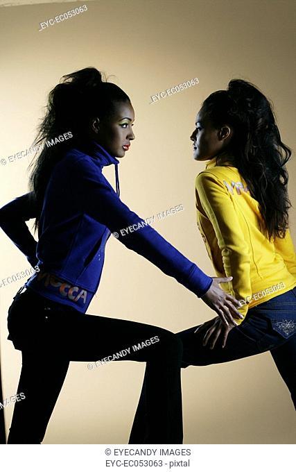 Young African American women posing, studio shot