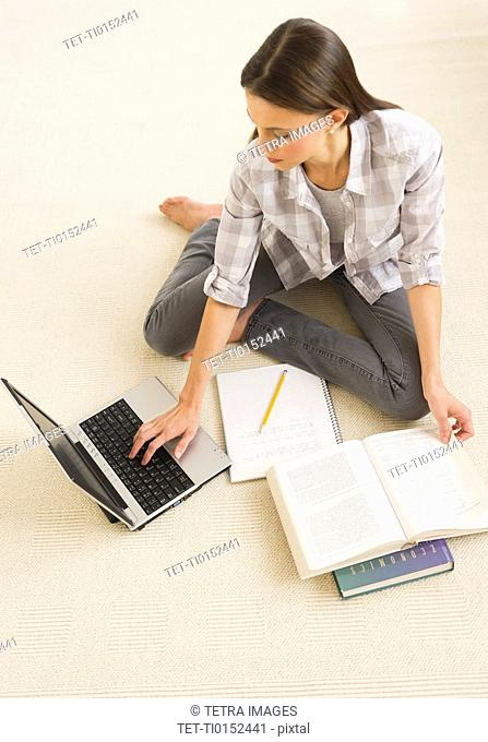 Woman studying at home