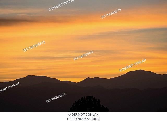 USA, Colorado, Denver, Romantic sky over mountain range