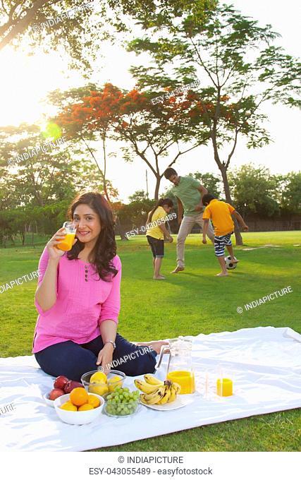 Portrait of woman having juice