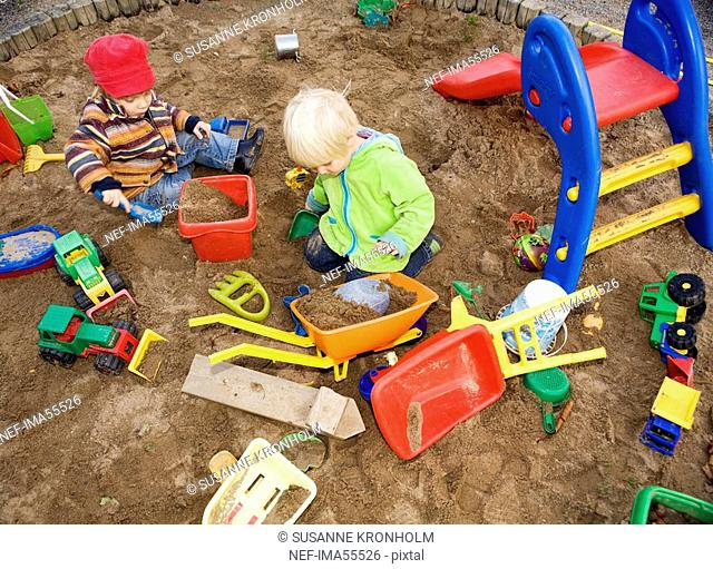 A child playing in a sandpit Sweden