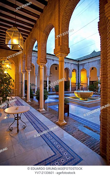 """Courtyard of the Parador de Carmona, Neomudejar style built next to the Fortress of the King Don Pedro I """""""" The Cruel"""""""". Carmona, Seville, Andalusia, Spain"""