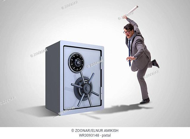 Angry man with baseball bat hitting money safe