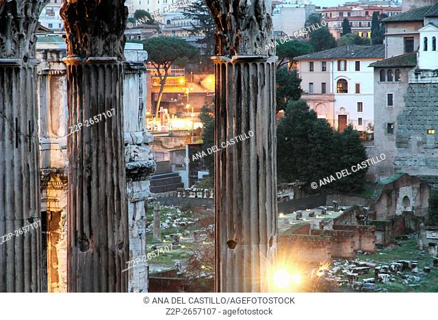 The columns of the Temple of Saturn, Arch of Septimius Severus and the medieval church in the Roman Forum, Rome, Italy