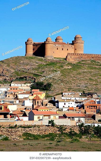 View of the castle, built 1509 ? 1512, (Castillo de La Calahorra) and town, Lacalahorra, Granada Province, Andalusia, Spain