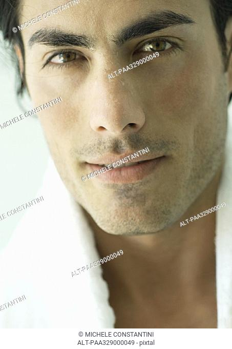 Man with towel around neck, close-up