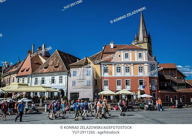 Historical houses and tower of Saint Mary Cathederal on a Small Square, Historic Center of Sibiu city of Transylvania region, Romania